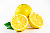Fresh juicy lemon with leaves, isolated on white background