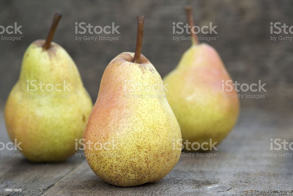 Fresh juicy pears in rustic wooden setting royalty-free stock photo