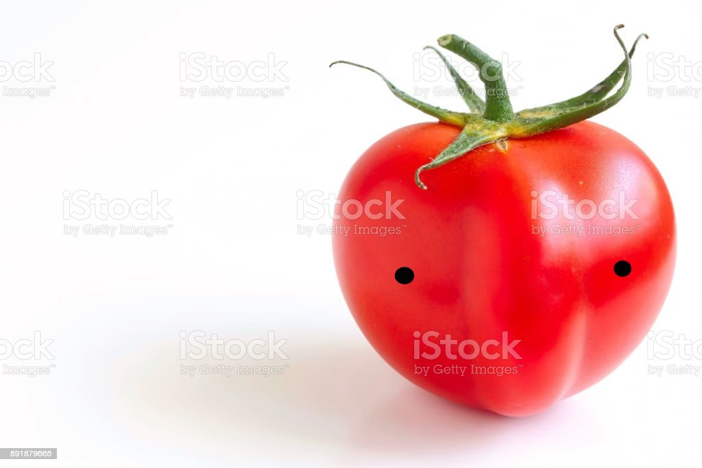 Fresh Juicy Red Tomato With Face stock photo