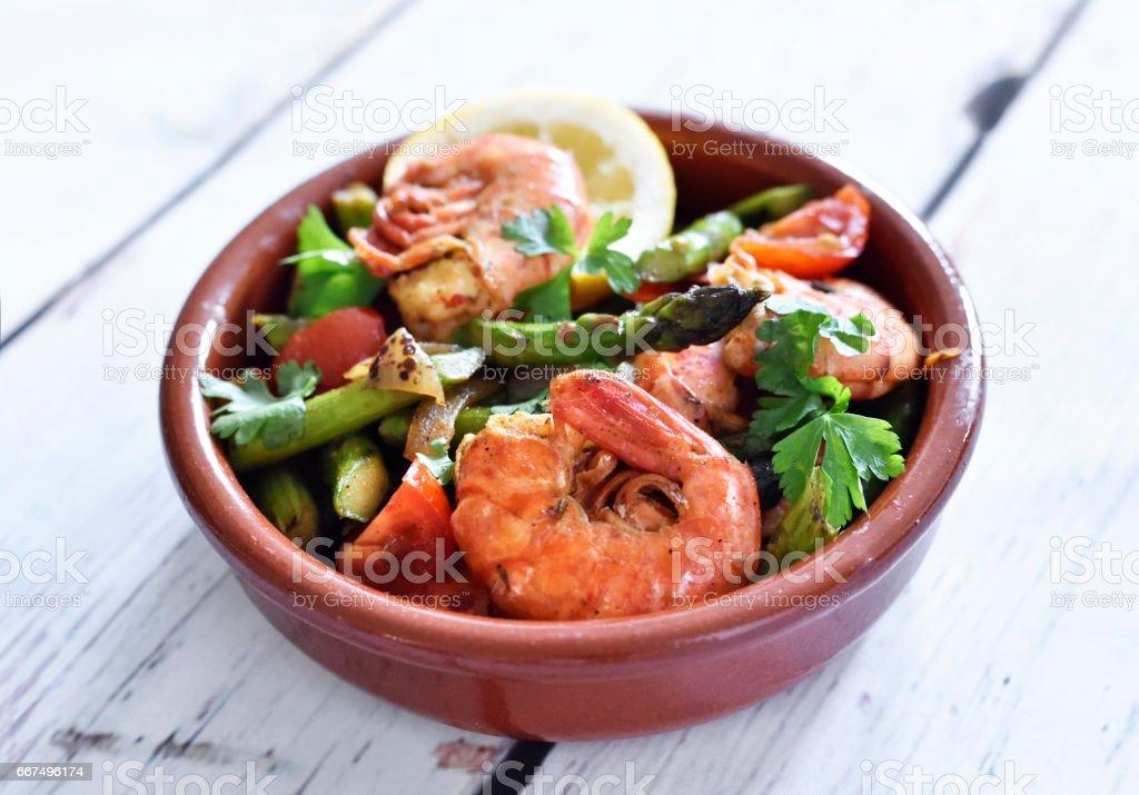Fresh jumbo shrimps and green asparagus, delicious dish stock photo
