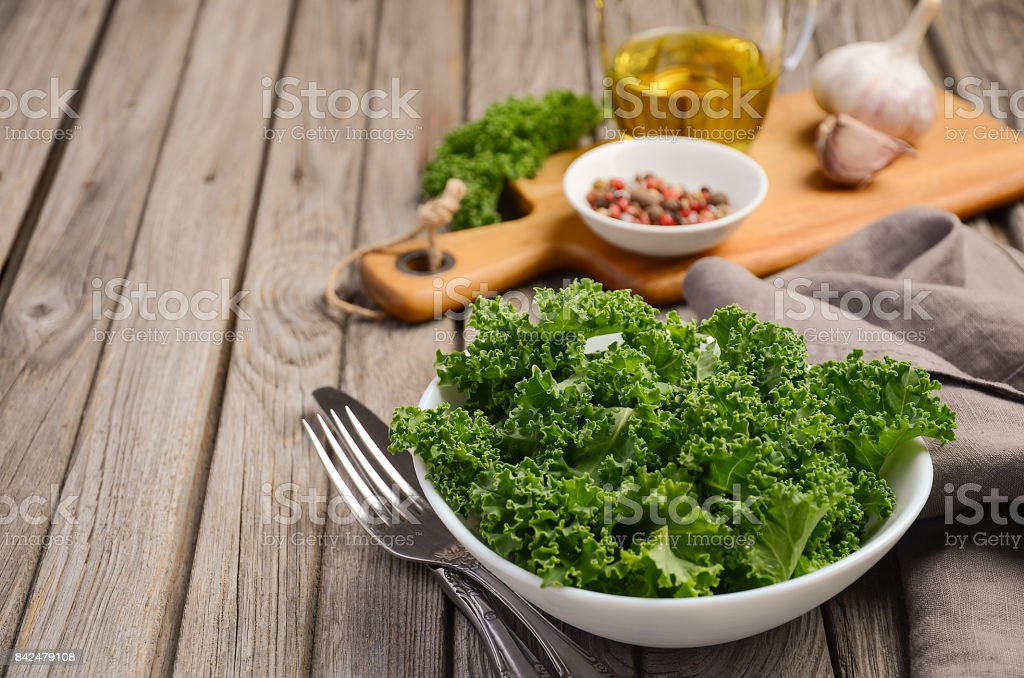 Fresh kale with olive oil, garlic and pepper stock photo