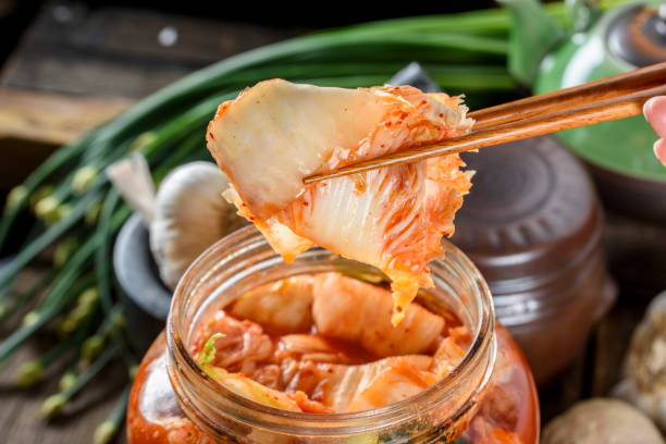 Fresh Kimchee Fresh Kimchee in glass bowl kimchee stock pictures, royalty-free photos & images