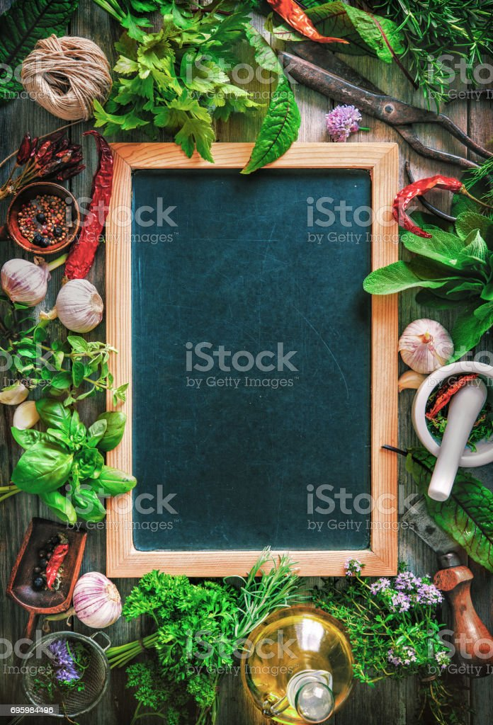 Fresh kitchen herbs and spices on wooden table stock photo