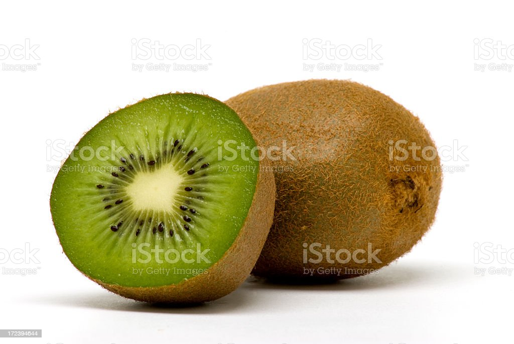 A fresh kiwi fruit cut open to reveal the green center stock photo