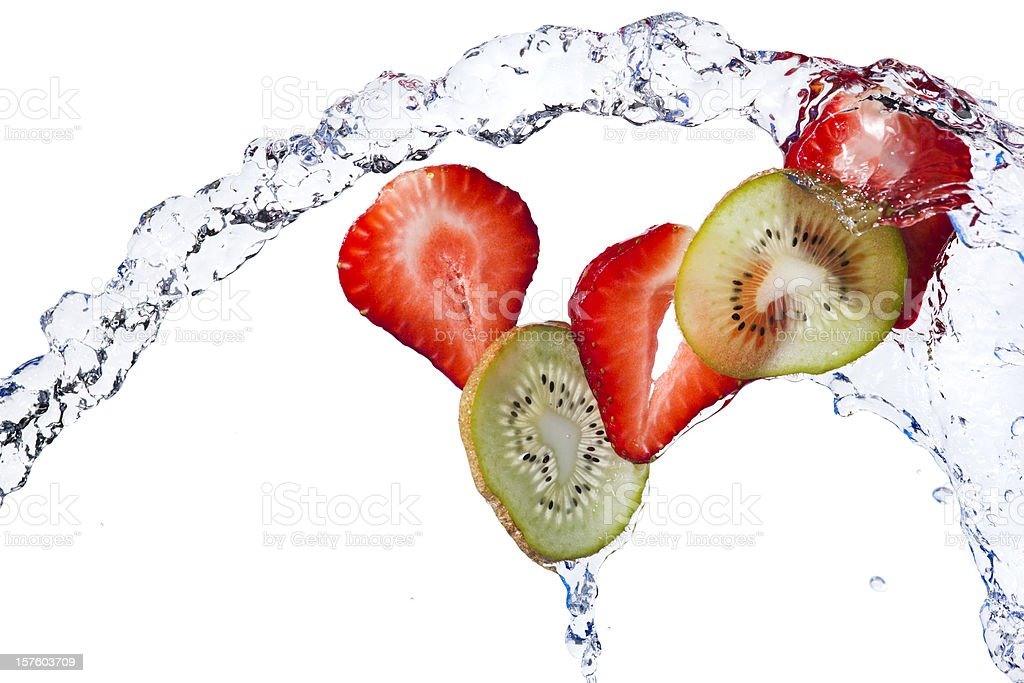 Fresh Kiwi, Strawberry Slices Tossed With Water on White Background stock photo