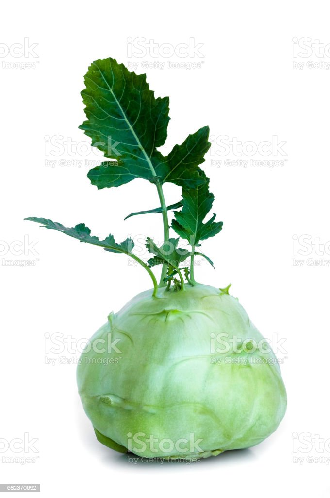 Fresh kohlrabi with green leaves on isolated white backround Lizenzfreies stock-foto