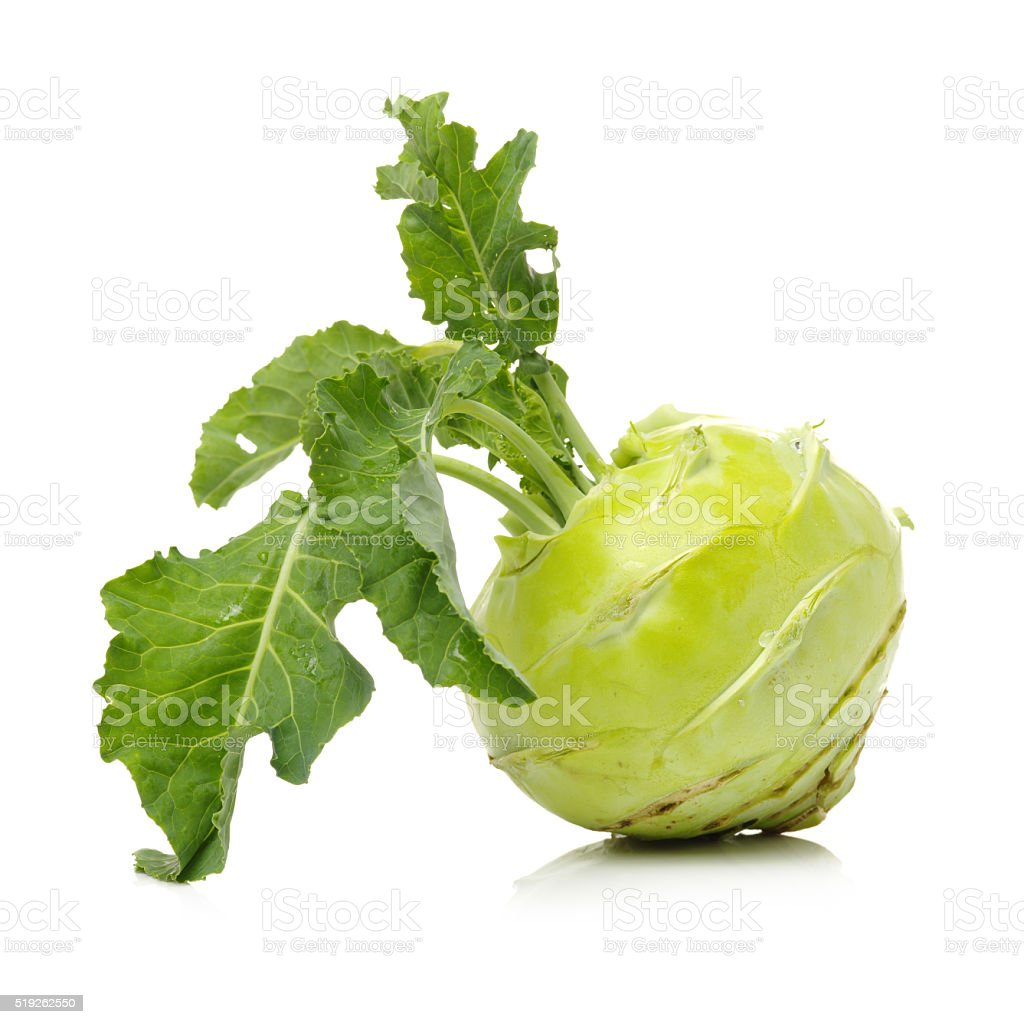 Fresh kohlrabi with green leaves stock photo