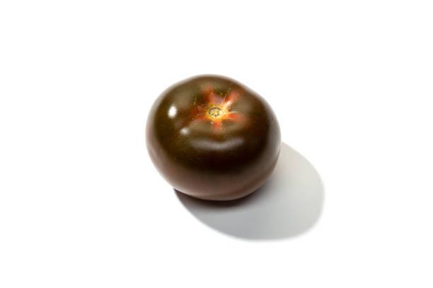 Fresh kumato tomato isolated stock photo