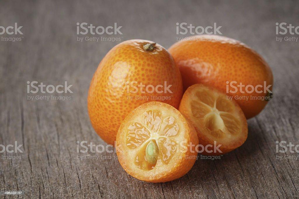fresh kumquat on wood table stock photo
