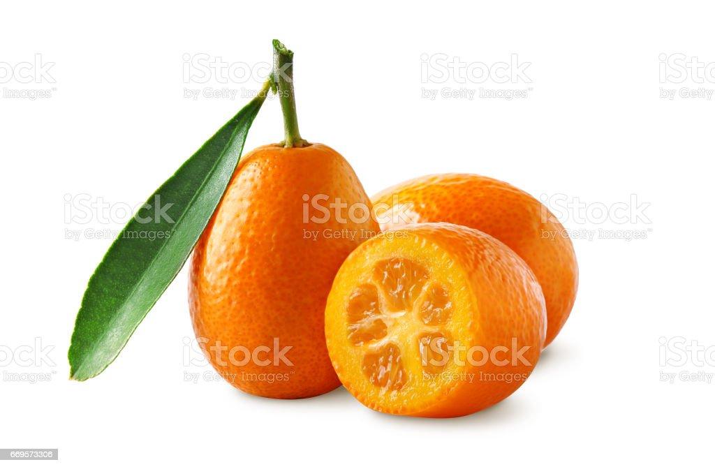 Fresh kumquats isolated on white background. Whole and sliced. stock photo