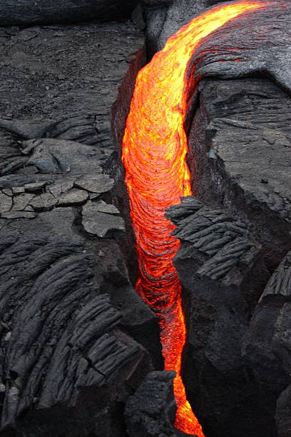 Fresh Lava from the Hawaiian Islands Fresh Lava exuding from the Big Island, Hawaii near Volcano National Park lava stock pictures, royalty-free photos & images