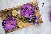 Purple, Violet, Lavender coloured juice/drink/soda. Top angle. Ginger Ale. Flavoured. Food Menu.