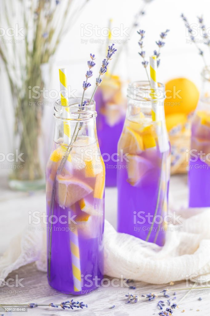 Fresh lavender violet cocktail with lemon and ice stock photo