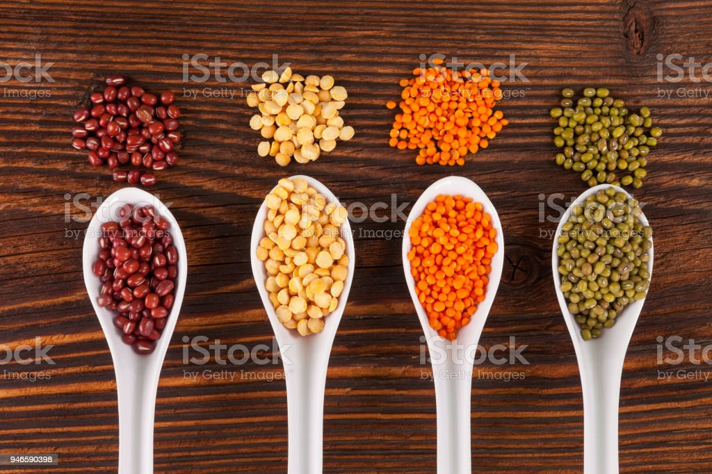 Fresh legumes in spoons stock photo