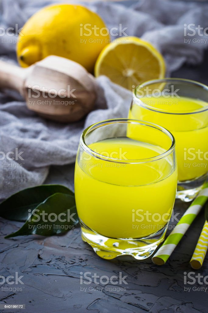 Fresh lemon juice on concrete background stock photo