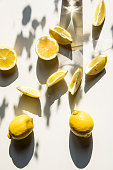 istock Fresh lemon slices on a table with trendy artistic shadows in the morning sunlight. 1140573945