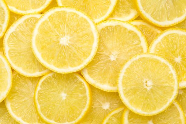 färska citronskivor mönster bakgrund, närbild - citron bildbanksfoton och bilder