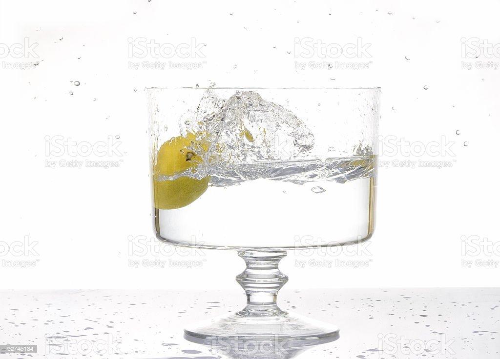 Fresh lemon splash into water stock photo
