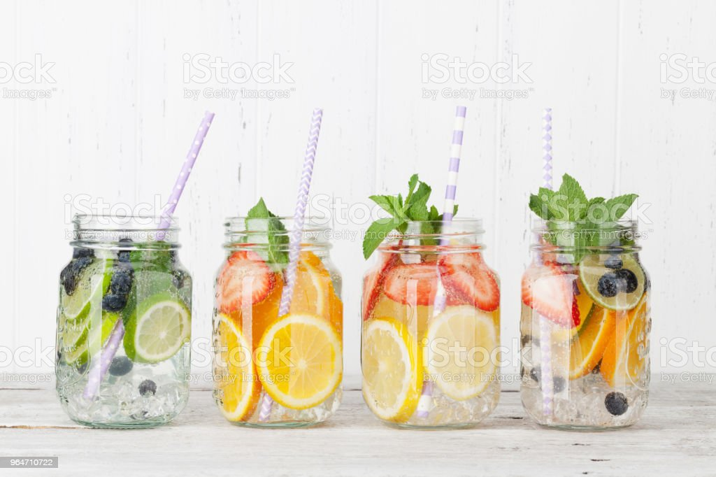 Fresh lemonade with summer fruits and berries royalty-free stock photo