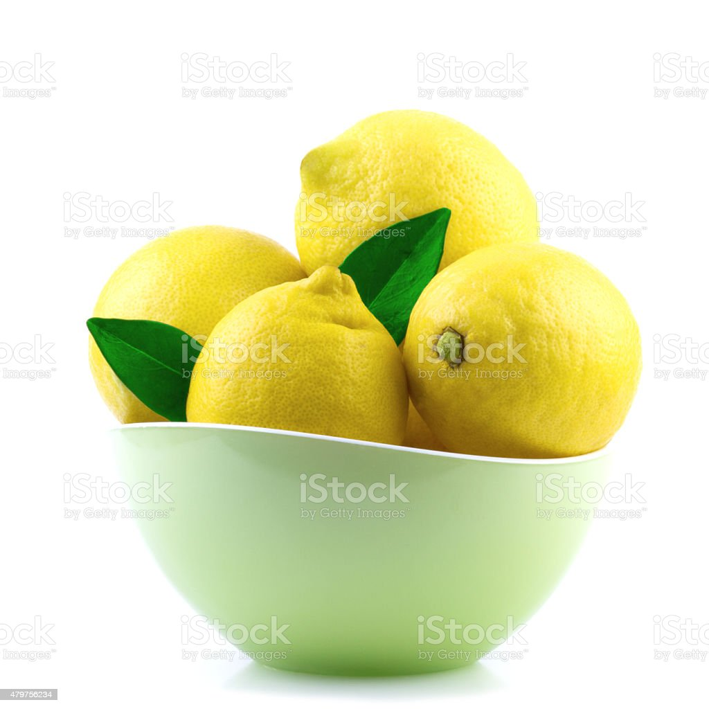 Fresh Lemons in Green Bowl stock photo
