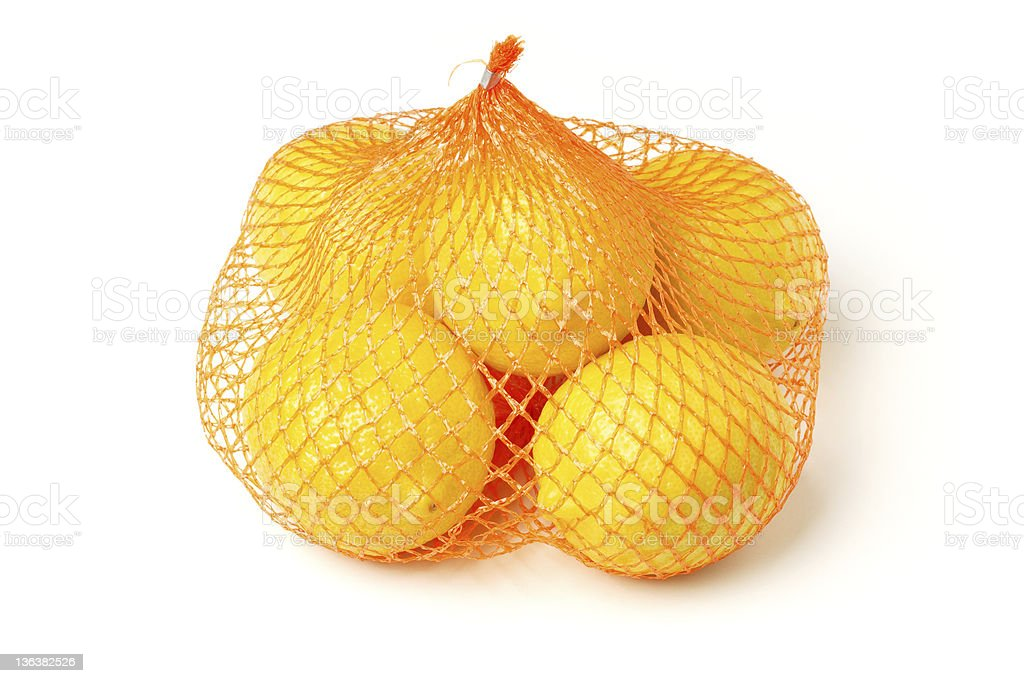 Fresh lemons in plastic sack royalty-free stock photo