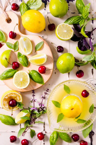 fresh lemons, limes and cherries from above - food styling stock photos and pictures