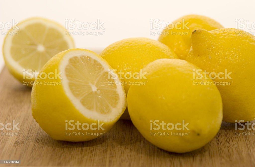 Fresh Lemons on a cutting board royalty-free stock photo