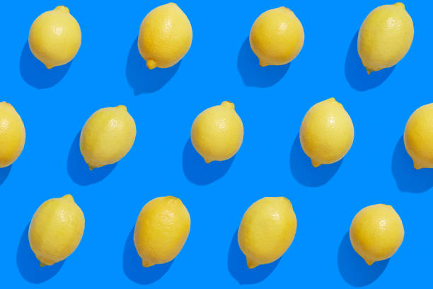 Fresh lemons on a saturated blue background stock photo