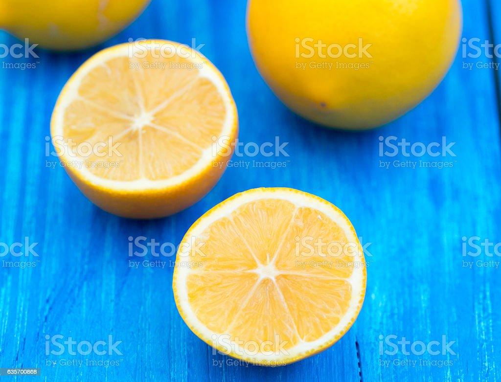 Fresh lemons on wooden background royalty-free stock photo