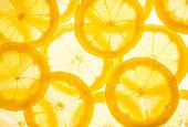 Fresh lemon slices.Yellow food background.