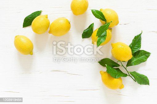 Fresh lemons with leaves, vitamin c concept, top view