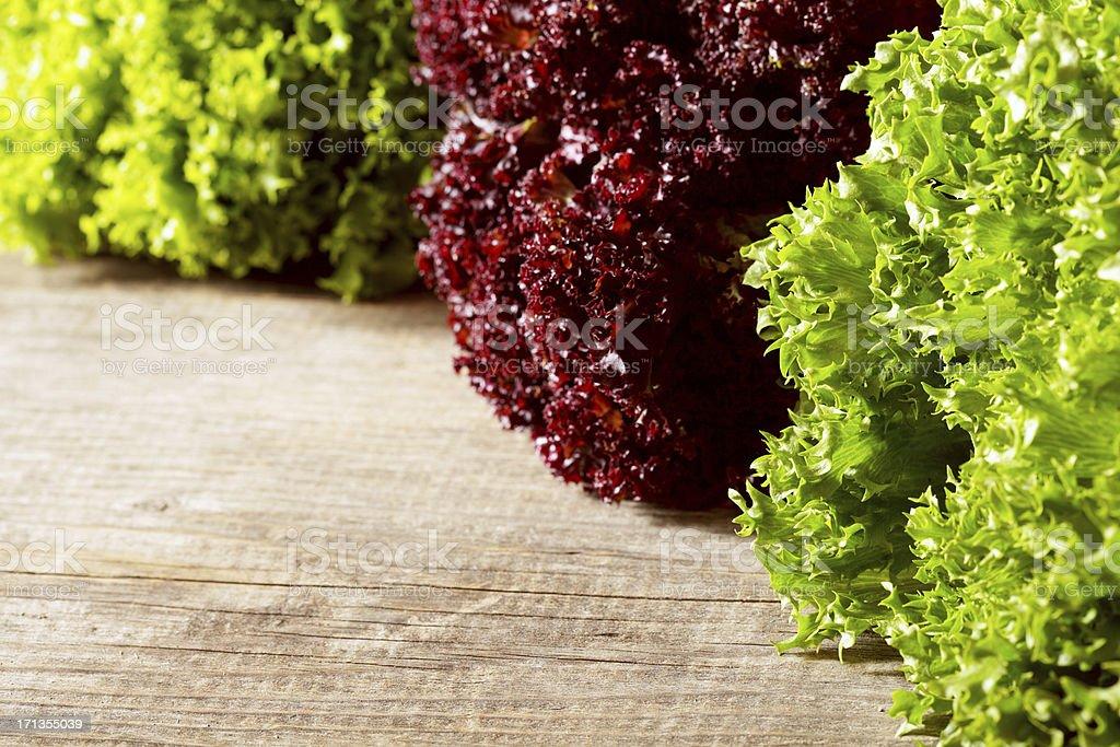 Fresh lettuce on wooden table stock photo