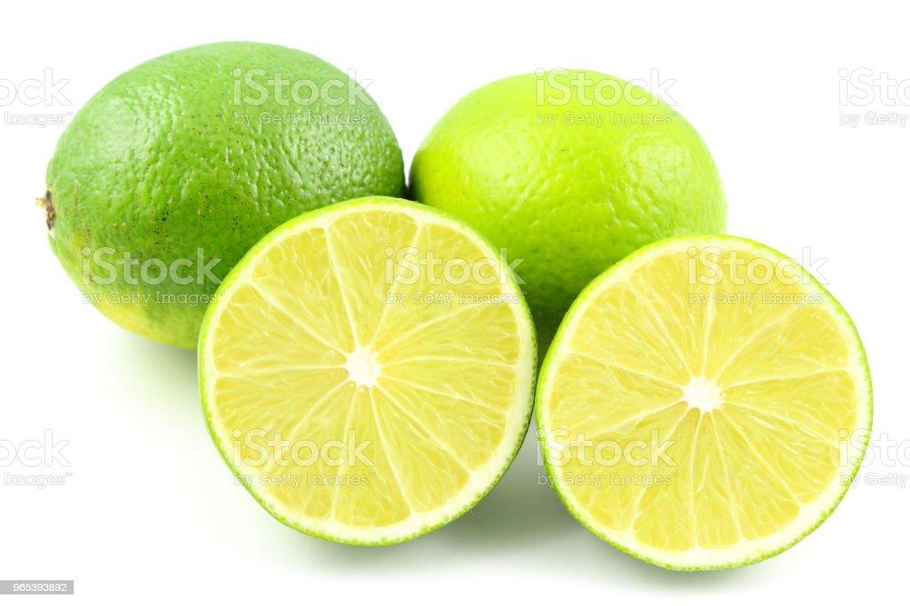 fresh lime fruits isolated on a white background zbiór zdjęć royalty-free