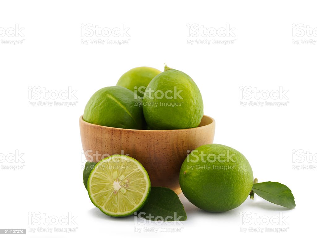 Fresh lime group in bowl on white background stock photo