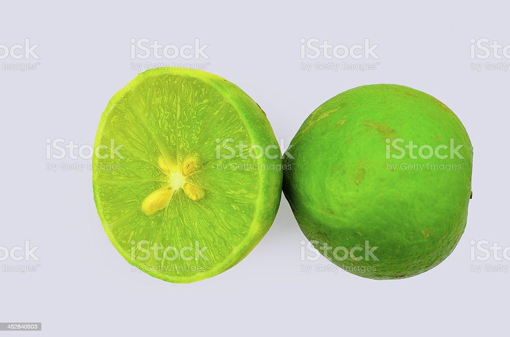 Fresh lime or lemon, half cut, isolated on white background royalty-free stock photo