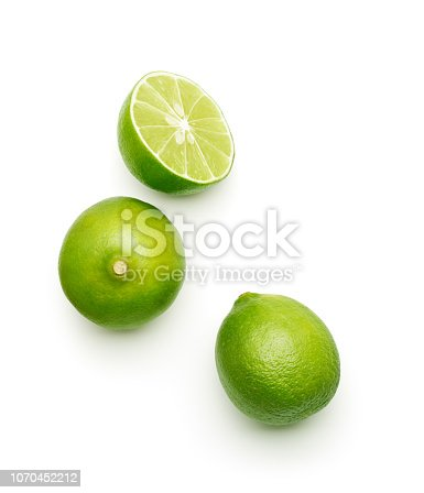 Fresh lime over white background, top view