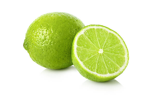 Fresh lime with a half Ripe lime with a half on white background lime stock pictures, royalty-free photos & images