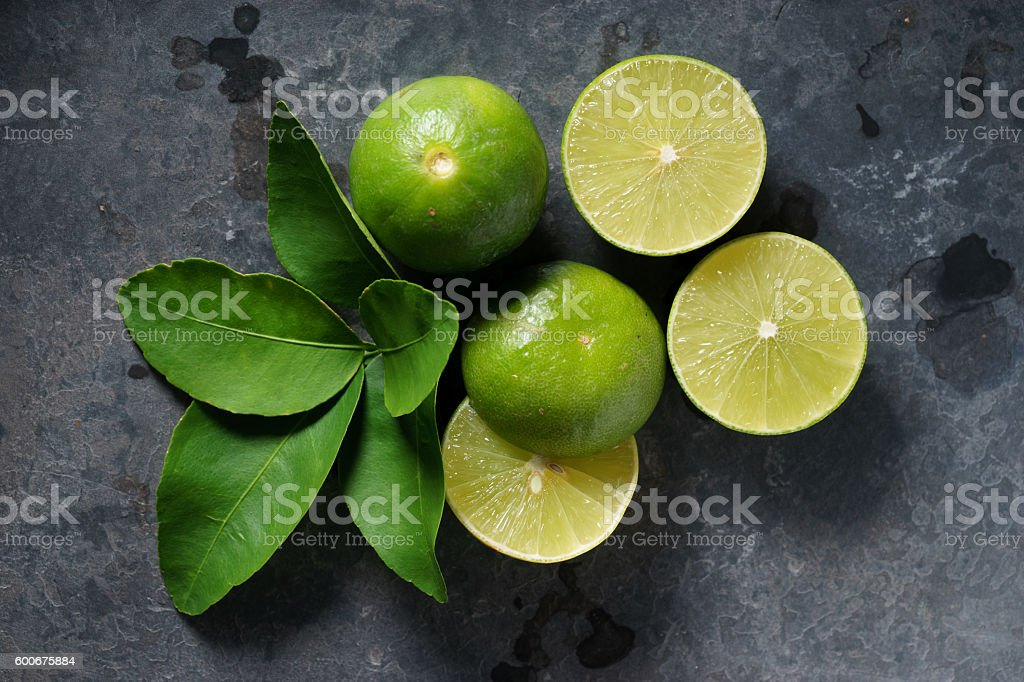 fresh limes on dark background stock photo
