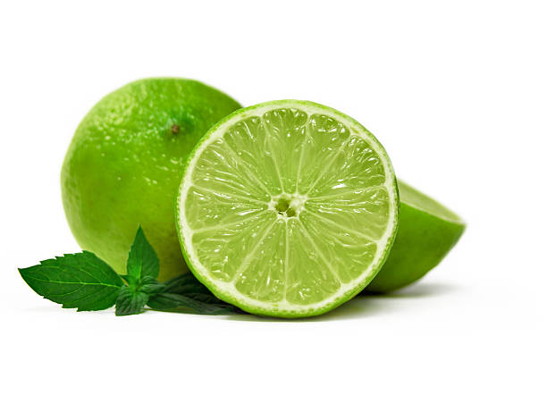 Fresh limes Fresh limes and mint leaves, isolated on white lime stock pictures, royalty-free photos & images