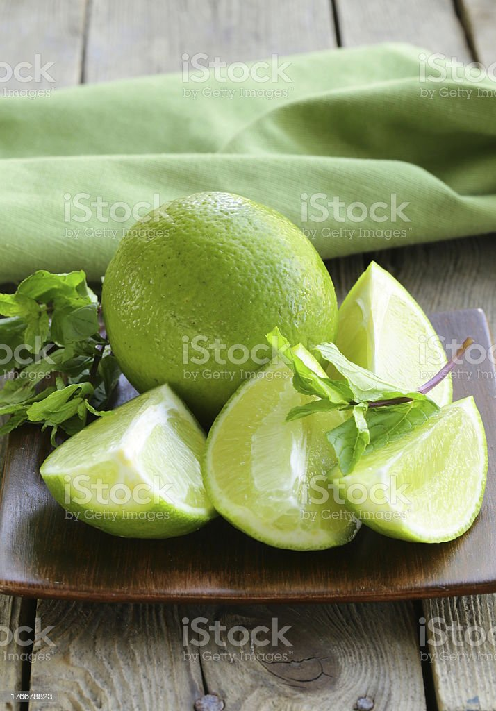 Fresh limes with green mint royalty-free stock photo