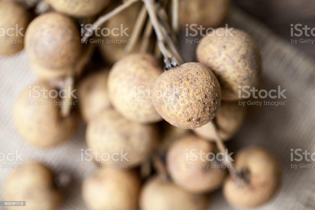 Fresh longan fruits on a wooden background stock photo
