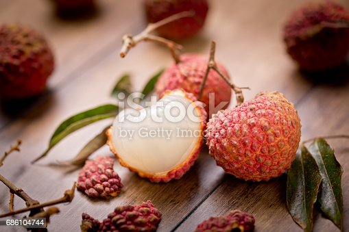 Set fresh lychee the skin is cut, whole, cut in half, with bone isolated on white background. Clipping Path. Full depth of field.