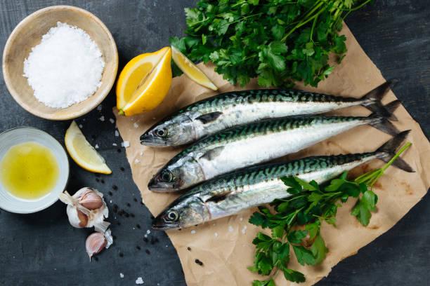 Fresh mackerel fish with ingredients to cook stock photo
