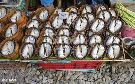 635931692 istock photo Fresh mackerel in wooden basket pattern in street market 636196008