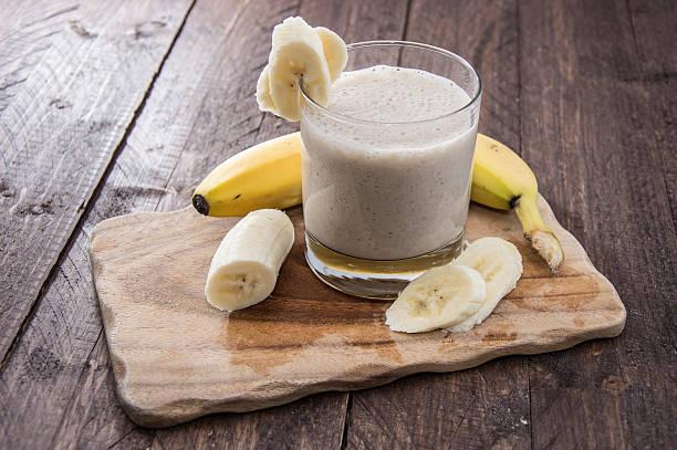 Fresh made milkshake using bananas stock photo