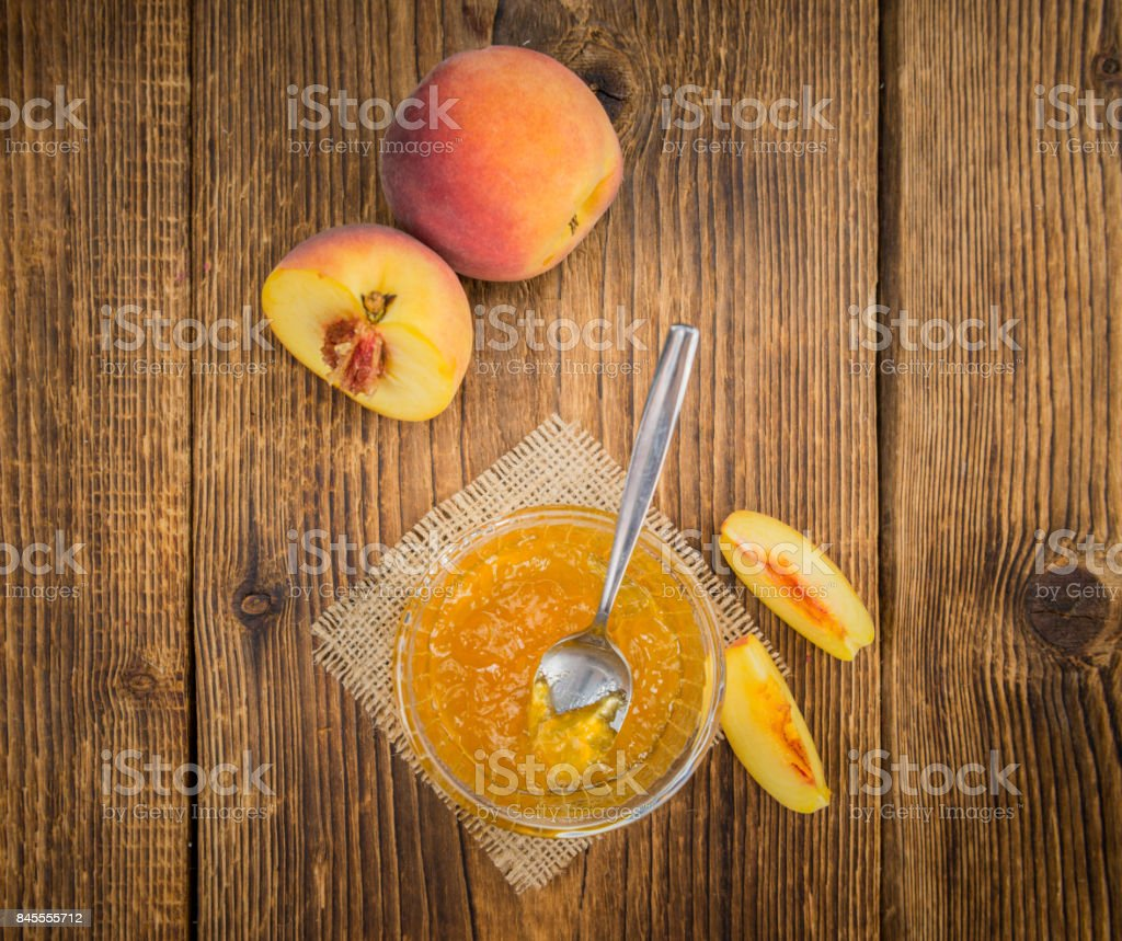 Fresh made Peach Jam on a rustic background stock photo
