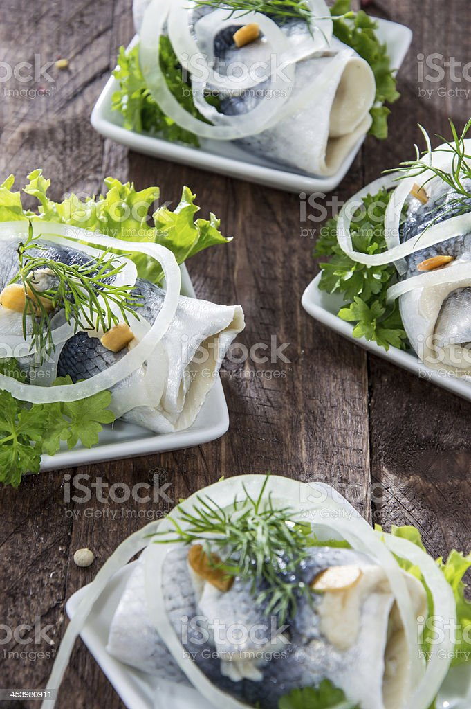 Fresh made Rollmop on a plate stock photo