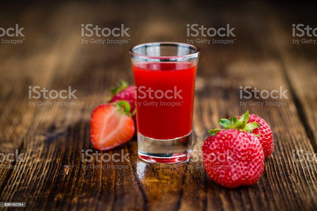 Fresh made Strawberry liqueur stock photo