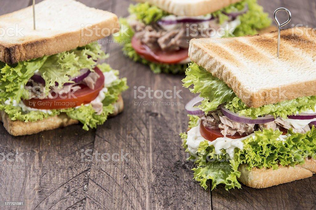 Fresh made Tuna Sandwiches on wood stock photo