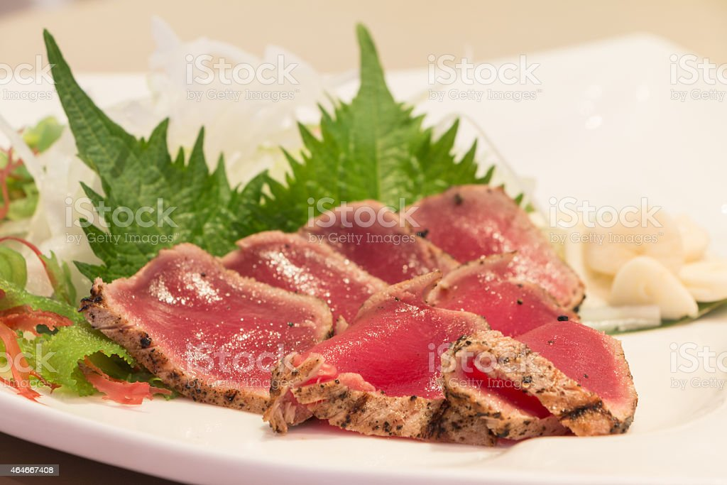 Fresh maguro tataki with vegetable stock photo
